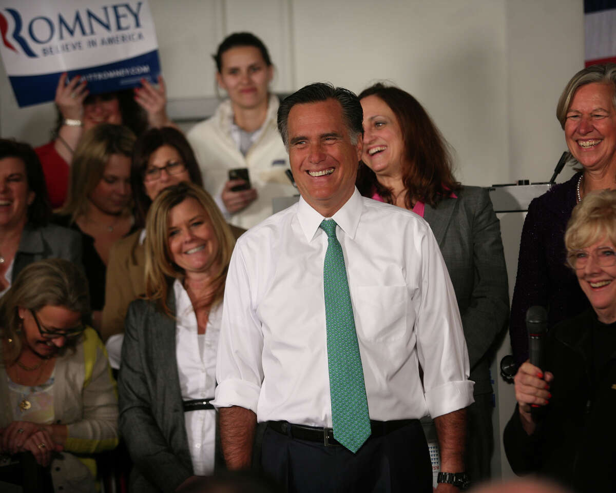 Republican presidential candidate Mitt Romney smiles as he is introduced during a campaign stop at AlphaGraphics at 915 Main Street in downtown Hartford on Wednesday, April 11, 2012.