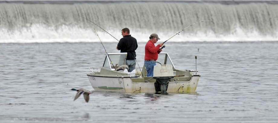 Two men fish from their boat in the Hudson River near the Troy Dam on Sunday April 15, 2012 as seen from the Green Island, NY side of the river.  (Philip Kamrass / Times Union ) Photo: Philip Kamrass