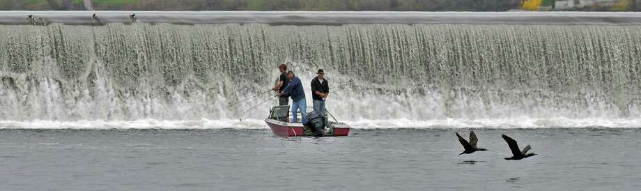 Men fish from their boat in the Hudson River near the Troy Dam on Sunday April 15, 2012 as seen from the Green Island, NY side of the river.  (Philip Kamrass / Times Union ) Photo: Philip Kamrass