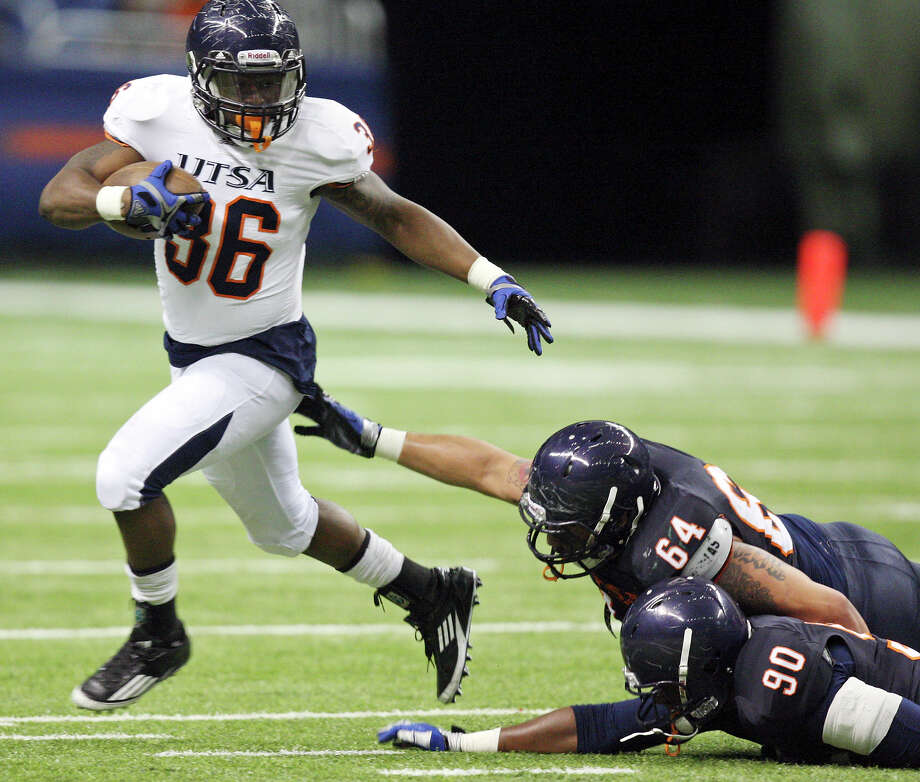 Evans Okotcha (from left) looks for running room around Franky Anaya and Jarron Harris during the 2012 UTSA Football Fiesta Spring Game, Sunday, April 15, 2012 at the Alamodome. Photo: EDWARD A. ORNELAS, San Antonio Express-News / © SAN ANTONIO EXPRESS-NEWS (NFS)