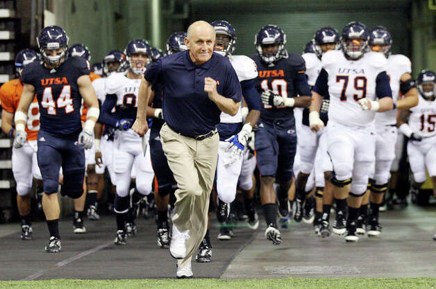 UTSA head football coach Larry Coker leads the team onto the field before the 2012 UTSA Football Fiesta Spring Game, Sunday, April 15, 2012 at the Alamodome. Photo: EDWARD A. ORNELAS, San Antonio Express-News / © SAN ANTONIO EXPRESS-NEWS (NFS)