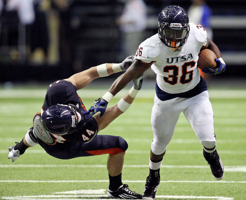 Evans Okotcha (right) looks for running room around Steven Kurfehs during the 2012 UTSA Football Fiesta Spring Game, Sunday, April 15, 2012 at the Alamodome.
