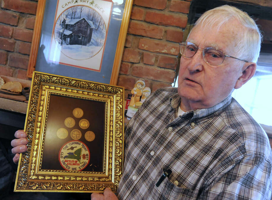 Sydney Thomas talks about trying to find two 24Kt gold medallions a group of locals created in 1977 to celebrate the 200th anniversary of the Revolutionary War April 13, 2012 in Stillwater, N.Y. Here he holds his collection of the gold medallions. (Lori Van Buren / Times Union) Photo: Lori Van Buren