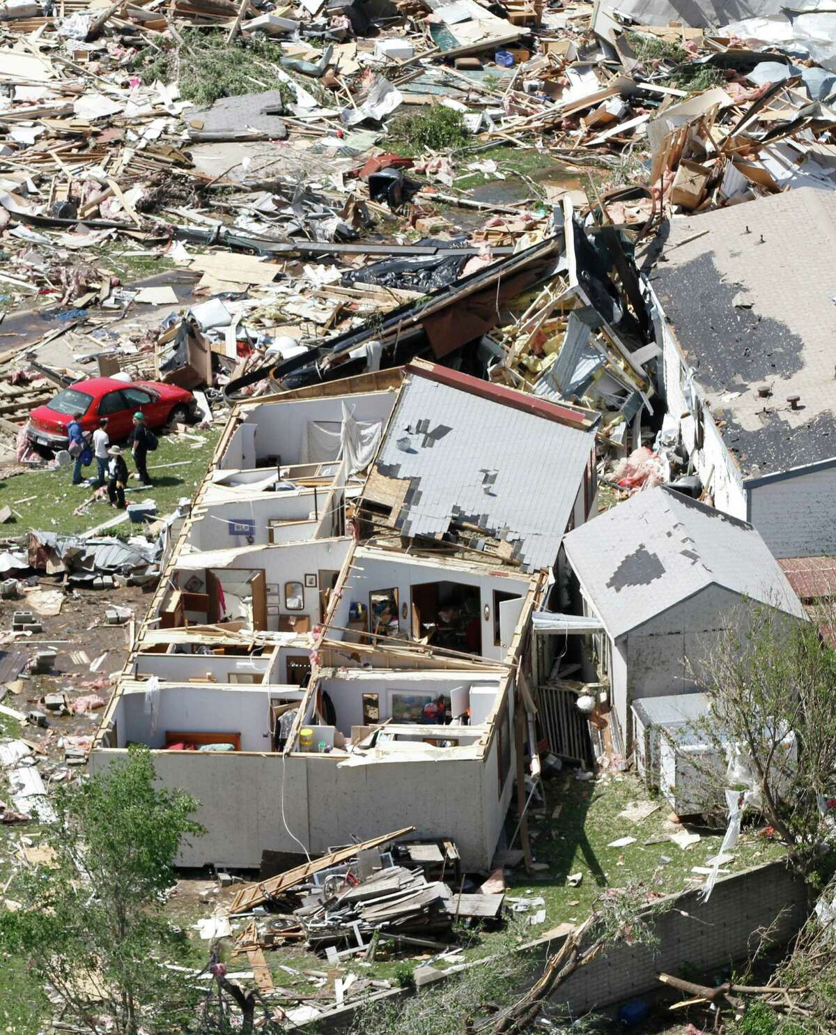An aerial view of the destruction of the Oaklawn neighborhood in Wichita, Kansas, on Sunday, April 15, 2012. The damage was caused by one of several tornadoes that the state on Saturday, April 14, 2012. (AP Photo/Jeff Tuttle)