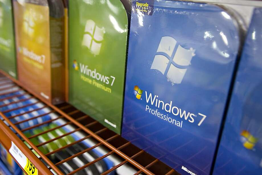Copies of Microsoft Windows 7 are arranged for a photograph at a Staples store in New York, U.S., on Thursday, Oct. 22, 2009. Microsoft Corp. will begin selling the Windows 7 operating system today, an effort to reverse three quarters of declining Windowssales and fend off Apple Inc.'s gains in personal computers. Photographer: Daniel Acker/Bloomberg Photo: Daniel Acker, Bloomberg