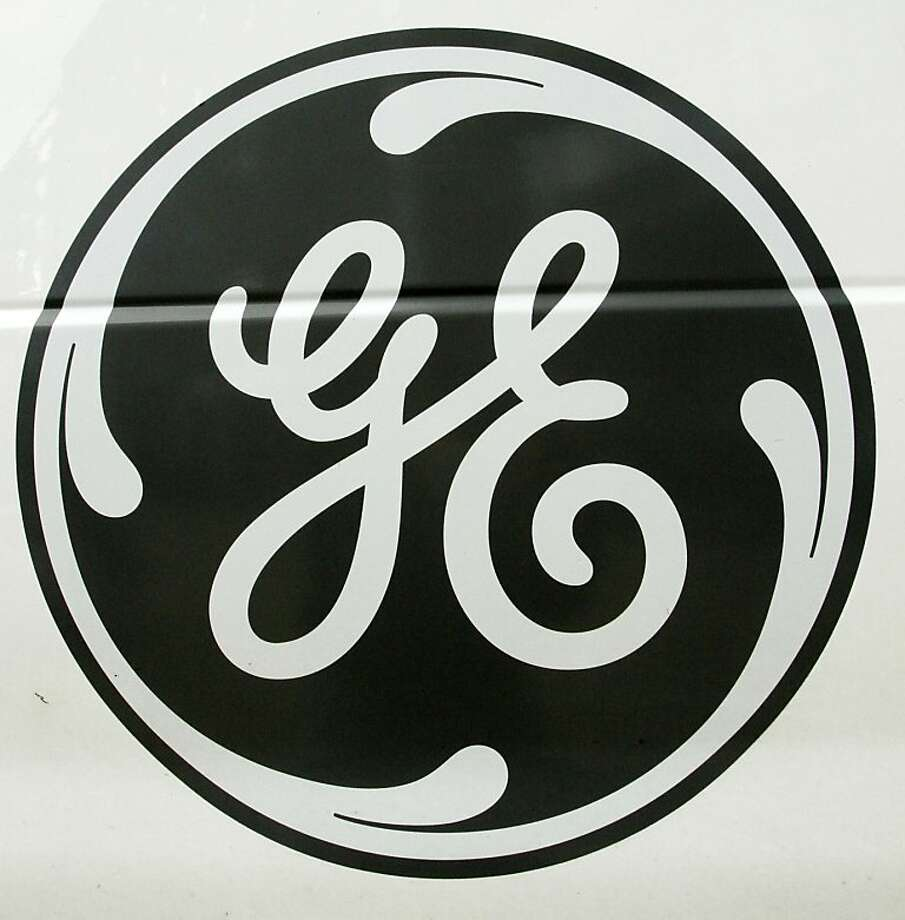The General Electric logo is seen on the side of an appliance repair van, Friday, Oct. 15, 2010, in a Pittsburgh Home Depot store. The industrial and financial giant said that sales of industrial equipment, everything from wind turbines to jet engines tolocomotives, lagged in the third quarter. Photo: Gene J. Puskar, AP