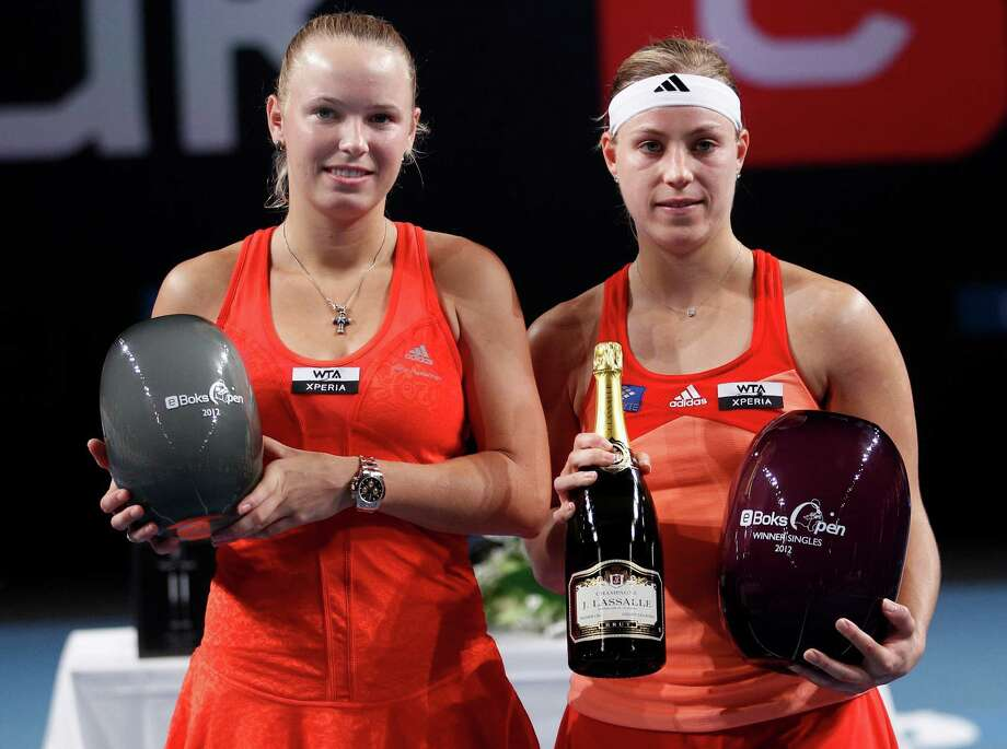 Danish tennis player Caroline Wozniacki, left, and German Angelique Kerber pose with their trophies after Kerber  beat Wozniacki 6-4, 6-4 in the eBoks Open finals in Copenhagen Denmark  on Sunday, April 15, 2012. (AP Photo/POLFOTO, Lars Poulsen) DENMARK OUT Photo: Lars Poulsen / POLFOTO