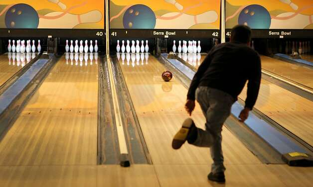 A bowler sends a bowling ball down a lane at Serra Bowl in Daly City on Sunday. Generations of bowlers met at Serra Bowl in Daly City on Sunday for the alley's final day of operation. The Serra Bowling alley opened 51 years ago, and has hosted many community supportive events. Photo: Kevin Johnson, The Chronicle