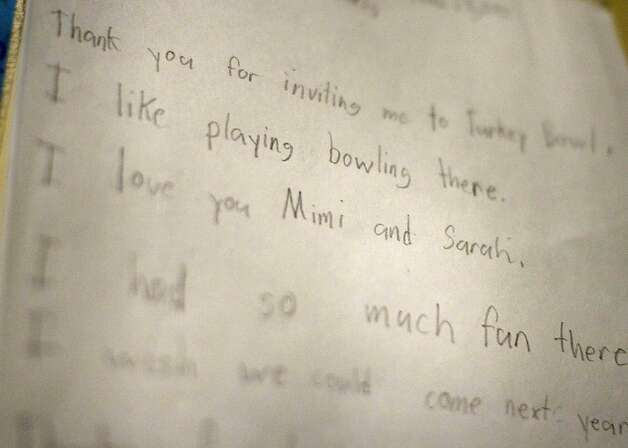 A thank you letter from a young child hangs in the Serra Bowl manager's office on Sunday. Generations of bowlers met at Serra Bowl in Daly City on Sunday for the alley's final day of operation. The Serra Bowling alley opened 51 years ago, and has hosted many community supportive events. Photo: Kevin Johnson, The Chronicle