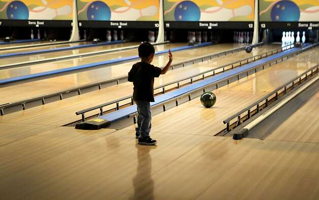 Jarel Cristotal, 3, hurls a bowling ball down a lane at Serra Bowl on Sunday during the alley's final day of business. Generations of bowlers met at Serra Bowl in Daly City on Sunday for the alley's final day of operation. The Serra Bowling alley opened 51 years ago, and has hosted many community supportive events. Photo: Kevin Johnson, The Chronicle