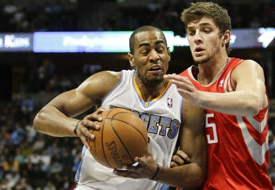 April 15: Nuggets 101, Rockets 86Nuggets guard Arron Afflalo, left, drives past Rockets forward Chandler Parsons during the fourth quarter. Afflalo tied a game high with 20 points on 9-of-15 shooting to help send the Rockets to their third straight loss. Record: 32-28.  (Barry Gutierrez / Associated Press)