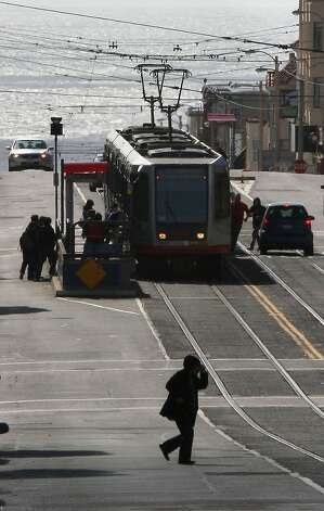 Pedestrians boarding the bus on Taravel St. at 22nd Ave. in San Francisco, Calif., on Friday, April 13, 2012.  An SFMTA (San Francisco Municipal Transportation Agency) proposal for free Muni for youth will be considered by the MTA board early next week. Photo: Liz Hafalia, The Chronicle