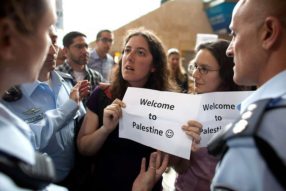 """TEL AVIV, ISRAEL - APRIL 15:  (ISRAEL OUT) Left wing Israeli activists are arrested by Israeli police as they demonstrate in favor of the """"Welcome to Palestine"""" fly-in protest on April 15, 2012 at the Ben Gurion Air Port near Tel Aviv, Israel. Some 650 policemen were stationed at the airport as hundreds of activists and protesters were due to arrive as part of the """"Welcome to Palestine"""" fly-in protest. (Photo by Uriel Sinai/Getty Images) Photo: Uriel Sinai, Getty Images"""