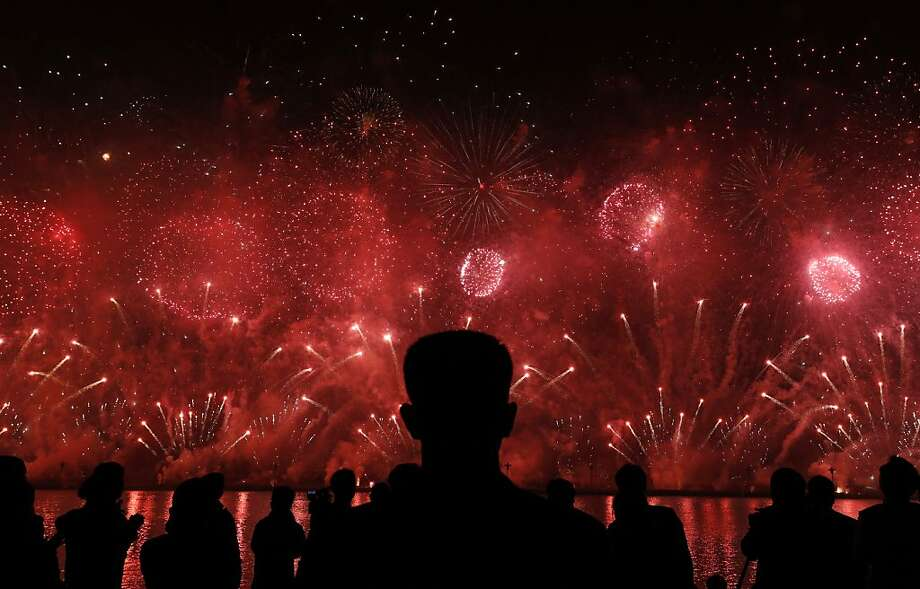 A North Korean security guard watches fireworks in Pyongyang to celebrate 100 years since the birth of the North Korean founder Kim Il Sung on Sunday, April 15, 2012. (AP Photo/Vincent Yu) Photo: Vincent Yu, Associated Press