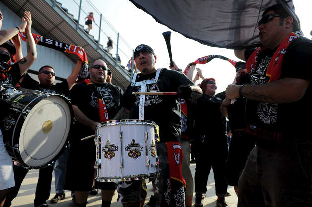 "Members of the San Antonio Scorpions fan group ""The Casuals"" play drums and sing during the Scorpions' home opener of their inaugural season in the North American Soccer League (NASL) on Sunday, April 15, 2012 at Heroes Stadium. Photo: John Albright, For The Express-News"