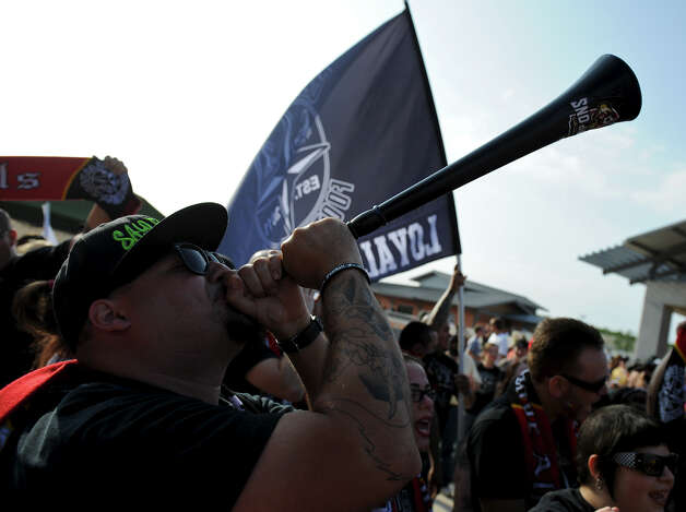 A San Antonio Scorpions fan blows a horn during the Scorpions' home opener of their inaugural season in the North American Soccer League (NASL) on Sunday, April 15, 2012 at Heroes Stadium. Photo: John Albright, For The Express-News