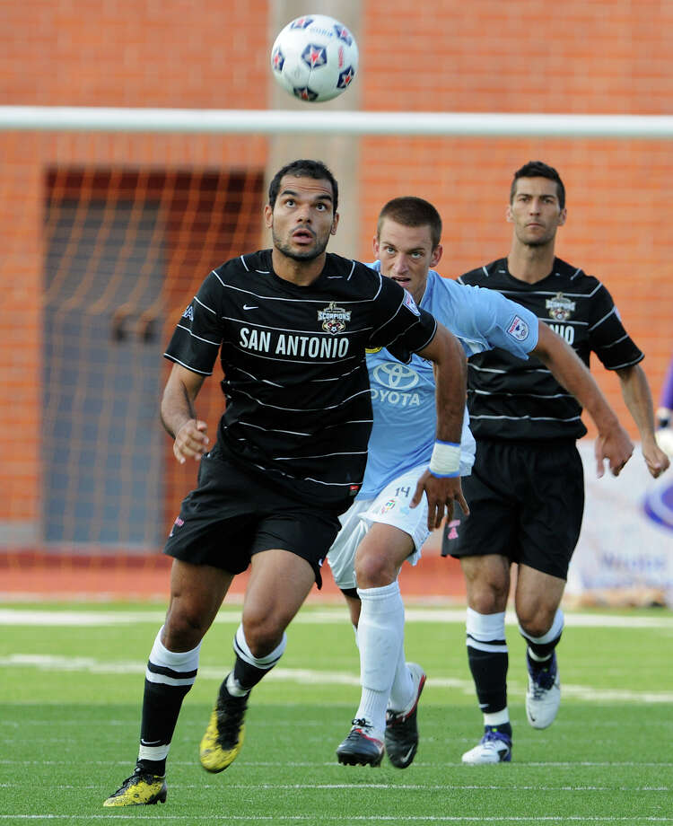 Pablo Campos of the Scorpions keeps his eye on the ball during the team's inaugural home game at Heroes Stadium. The Scorpions struggled in their second game of the season. Photo: John Albright, For The Express-News