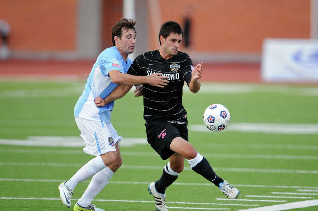 The San Antonio Scorpions' Blake Wagner (right) keeps the ball away from the Puerto Rico Islanders' Noah Delgado (left) during the Scorpions' home opener of their inaugural season in the North American Soccer League (NASL) on Sunday, April 15, 2012 at Heroes Stadium. Photo: John Albright, For The Express-News