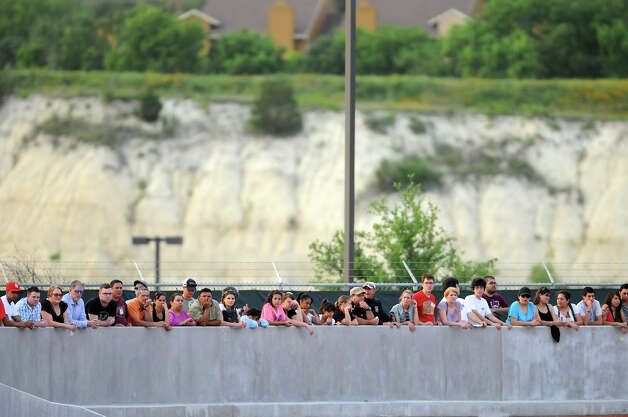 Fans stand on a walkway to watch the San Antonio Scorpions' home opener of their inaugural season in the North American Soccer League (NASL) on Sunday, April 15, 2012 at Heroes Stadium. Photo: John Albright, For The Express-News