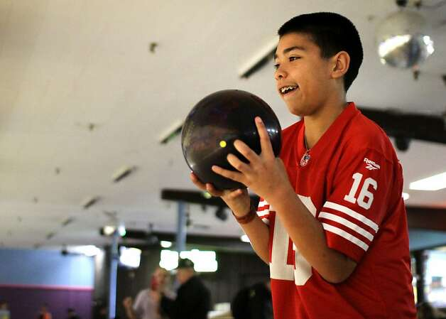 Jaylen Franks, 13, lines up his shot at Serra Bowl in Daly City on Sunday during the alley's final day of business. Generations of bowlers met at Serra Bowl in Daly City on Sunday for the alley's final day of operation. The Serra Bowling alley opened 51 years ago, and has hosted many community supportive events. Photo: Kevin Johnson, The Chronicle