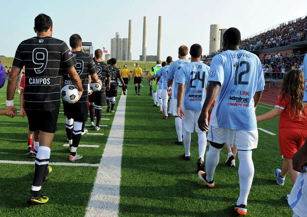 Members of the San Antonio Scorpions and the Puerto Rico Islanders walk out on the field before the Scorpions' home opener of their inaugural season in the North American Soccer League (NASL) on Sunday, April 15, 2012 at Heroes Stadium. Photo: John Albright, For The Express-News