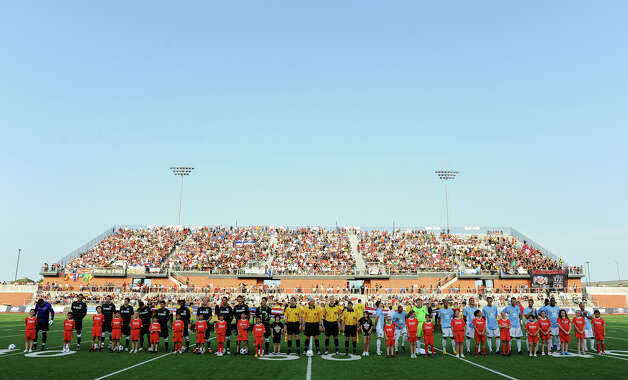 Members of the San Antonio Scorpions and the Puerto Rico Islanders stand on the field before the Scorpions' home opener of their inaugural season in the North American Soccer League (NASL) on Sunday, April 15, 2012 at Heroes Stadium. Photo: John Albright, For The Express-News