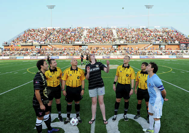 Morgan Hartman flips the coin before the Scorpions' home opener of their inaugural season in the North American Soccer League (NASL) on Sunday, April 15, 2012 at Heroes Stadium. Photo: John Albright, For The Express-News