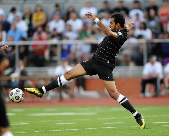 The San Antonio Scorpions' Pablo Campos leaps for a ball during the Scorpions' home opener of their inaugural season in the North American Soccer League (NASL) on Sunday, April 15, 2012 at Heroes Stadium. Photo: John Albright, For The Express-News