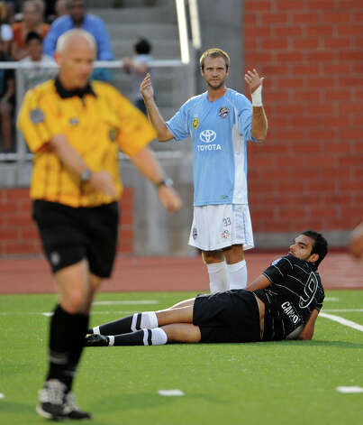 The Puerto Rico Islanders' Jay Needham (33) reacts after being called for a foul after tripping up the San Antonio Scorpions' Pablo Campos (9) during the Scorpions' home opener of their inaugural season in the North American Soccer League (NASL) on Sunday, April 15, 2012 at Heroes Stadium. Photo: John Albright, For The Express-News