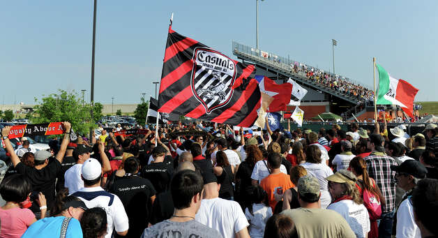 San Antonio Scorpions fans wave flags as they file into the stadium before the Scorpions' home opener of their inaugural season in the North American Soccer League (NASL) on Sunday, April 15, 2012 at Heroes Stadium. Photo: John Albright, For The Express-News