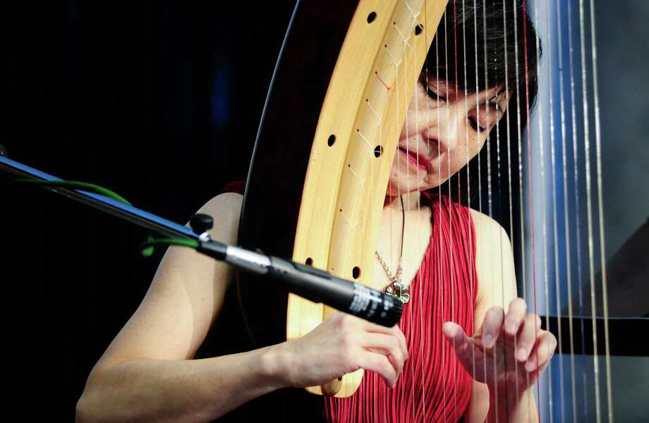 Tomoko Sugawara, a harpist from Tokyo, plays an ancient harp called a kugo during the Seattle Cherry Blossom & Japanese Cultural Festival at Seattle Center on Sunday, April 15, 2012. The annual festival features Taiko drumming, artisan demonstrations and celebrates Japanese tradition as well as modern influences. Photo: LINDSEY WASSON / SEATTLEPI.COM