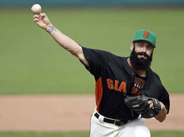 FILE - In this March 17, 2012, file photo, San Francisco Giants relief pitcher Brian Wilson throws against the Oakland Athletics during the seventh inning of a spring training baseball game in Scottsdale, Ariz. Wilson is likely headed for surgery on his right elbow after an MRI showed structural damage and an issue with the ligament, and his season could be in jeopardy. Manager Bruce Bochy and athletic trainer Dave Groeschner say the club will seek at least one other opinion and probably two, including from the renowned orthopedist Dr. James Andrews, who performs Tommy John elbow-reconstruction surgeries. (AP Photo/Marcio Jose Sanchez, File) Photo: Marcio Jose Sanchez, Associated Press