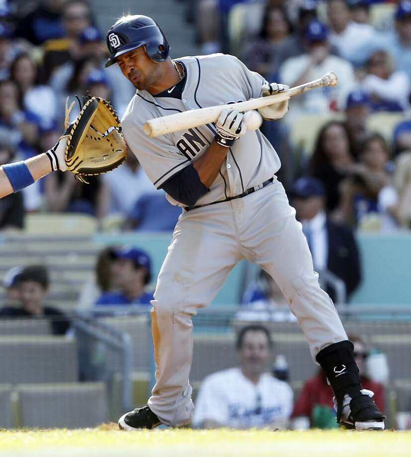 San Diego Padres' Jesus Guzman grounds into a controversial triple play by the Los Angeles Dodgers in the ninth inning of a baseball game in Los Angeles Sunday, April 15, 2012. The Dodgers won 5-4. (AP Photo/Reed Saxon) Photo: Reed Saxon, Associated Press