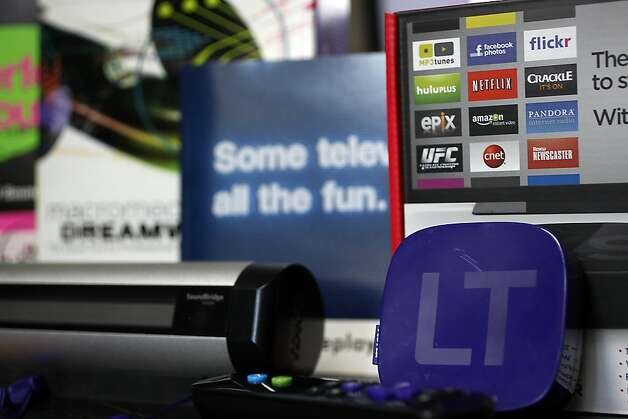 Roku 2 - a streaming player is the latest invention of Anthony Wood, shown in purple, next to it is a the internet streaming radio crated by Roku in 2005. We meet with Wood in his home office in Palo Alto, Calif. on April 13, 2012. Photo: Siana Hristova, The Chronicle