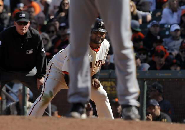 Pablo Sandoval keeps an eye on Pirates pitcher Jason Grilli for a chance to steal after walking in the eighth inning. The San Francisco Giants played the Pittsburgh Pirates at AT&T Park in San Francisco, Calif., on Sunday, April 15, 2012. The Giants lost 1-4. Photo: Carlos Avila Gonzalez, The Chronicle