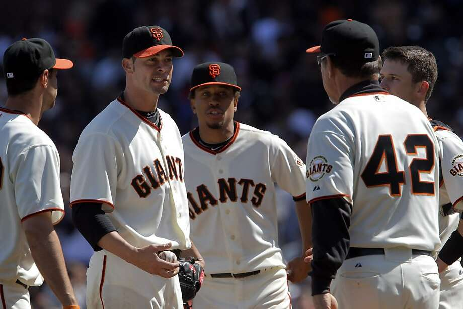 Giants manager Bruce Bochy comes to the mound to relieve starting pitcher Ryan Vogelsong in the seventh inning. The San Francisco Giants played the Pittsburgh Pirates at AT&T Park in San Francisco, Calif., on Sunday, April 15, 2012. The Giants lost 1-4. Photo: Carlos Avila Gonzalez, The Chronicle