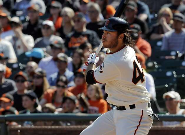 Brandon Crawford watches his seventh inning double hit off the wall in center field. The San Francisco Giants played the Pittsburgh Pirates at AT&T Park in San Francisco, Calif., on Sunday, April 15, 2012. The Giants lost 1-4. Photo: Carlos Avila Gonzalez, The Chronicle