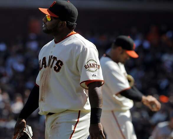 Pablo Sandoval returns to third after his throwing error in the eighth inning allowed Andrew McCutchen to score. The San Francisco Giants played the Pittsburgh Pirates at AT&T Park in San Francisco, Calif., on Sunday, April 15, 2012. The Giants lost 1-4. Photo: Carlos Avila Gonzalez, The Chronicle