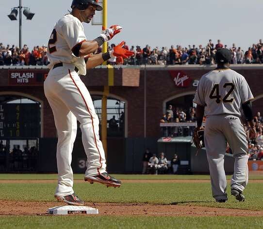 Giants' Angel Pagan jumps up and claps after hitting a triple in the eighth inning. But Pagan would not score in the inning. The San Francisco Giants played the Pittsburgh Pirates at AT&T Park in San Francisco, Calif., on Sunday, April 15, 2012. The Giants lost 1-4. Photo: Carlos Avila Gonzalez, The Chronicle