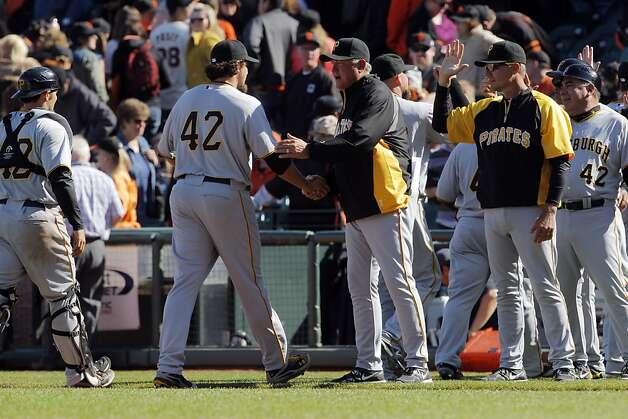 Pirates manager, Clint Hurdle congratulates closer Joel Hanrahan after the end of the game. The San Francisco Giants played the Pittsburgh Pirates at AT&T Park in San Francisco, Calif., on Sunday, April 15, 2012. The Giants lost 1-4. Photo: Carlos Avila Gonzalez, The Chronicle