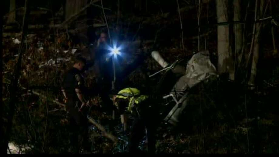 A Hartford Hospital spokeswoman says the passenger in a small helicopter that crash-landed in Farmington is in good condition. The Hartford Courant reports that Irene Van was reported to be conscious and alert after the helicopter piloted by state Rep. Bill Wadsworth crashed in a wooded area Saturday night. Photo: WTNH