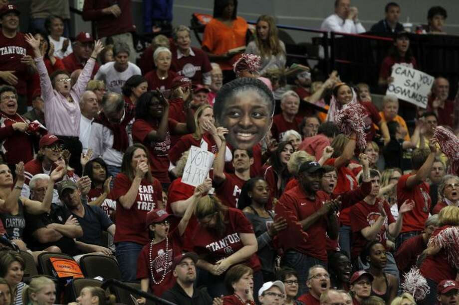 Stanford Cardinal fans cheer for a basket by Stanford Cardinal's Nneka Ogwumike (30) during their game against the Baylor Lady Bears in the first half for the NCAA women's Final Four semifinal this year. (Nhat V. Meyer / McClatchy-Tribune News Service)
