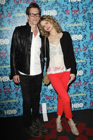"Actors Kevin Bacon, left, and Kyra Sedgwick pose at the premiere of the HBO original series ""Girls,"" Wednesday, April 4, 2012 in New York. The comedy premieres April 15, at  10:30p.m. EST on HBO. Photo: AP"
