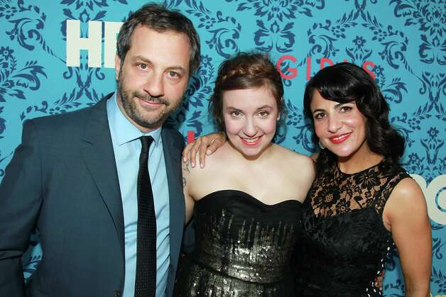 "Producers from left, Judd Apatow, Lena Dunham and Jenni Konner pose at the premiere of the HBO original series ""Girls,"" Wednesday, April 4, 2012 in New York. The comedy premieres April 15, at  10:30p.m. EST on HBO. Photo: AP"