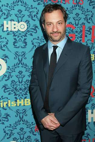 "Producer Judd Apatow poses at the premiere of the HBO original series ""Girls,"" Wednesday, April 4, 2012 in New York. The comedy, starring Allison Williams, Zosia Mamet Jemima Kirke, and Lena Dunham, premieres April 15, at  10:30p.m. EST on HBO. Photo: AP"