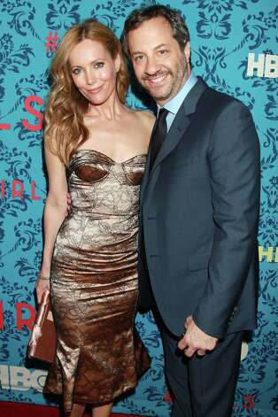 "Producer Judd Apatow, right, and his wife, actress Leslie Mann poses at the premiere of the HBO original series ""Girls,"" Wednesday, April 4, 2012 in New York. The comedy, starring Allison Williams, Zosia Mamet Jemima Kirke, and Lena Dunham, premieres April 15, at  10:30p.m. EST on HBO. Photo: AP"