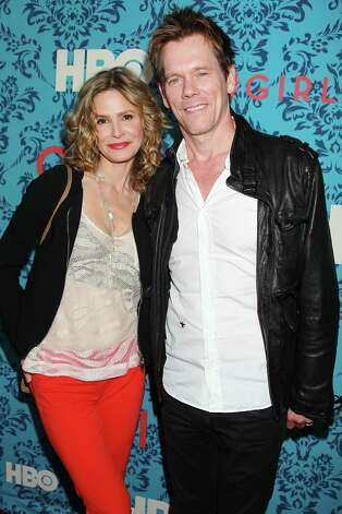 "Actors Kyra Sedgwick, left, and Kevin Bacon pose at the premiere of the HBO original series ""Girls,"" Wednesday, April 4, 2012 in New York. The comedy, starring Allison Williams, Zosia Mamet Jemima Kirke, and creator and executive producer Lena Dunham, premieres April 15, at  10:30p.m. EST on HBO. Photo: AP"
