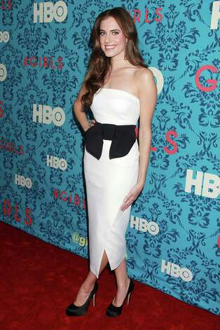 "Actress Allison Williams poses at the premiere of the HBO original series ""Girls,"" Wednesday, April 4, 2012 in New York. The comedy, starring Williams, Zosia Mamet Jemima Kirke, and creator and executive producer Lena Dunham, premieres April 15, at  10:30p.m. EST on HBO. Photo: AP"