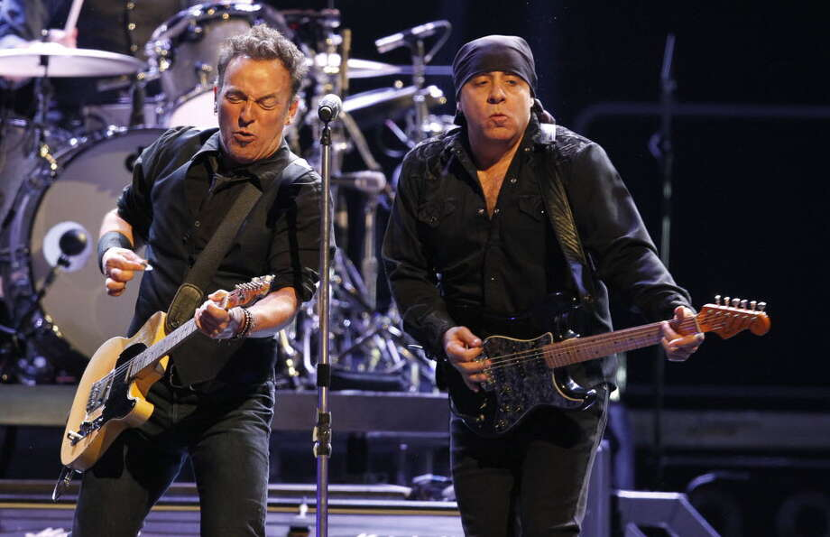 Bruce Springsteen, (L), and Steven Van Zandt perom at the First Niagara Center in Bufalo,NY on Friday, April 13, 2012. (AP Photo/The Buffalo News, Harry Scull Jr.)