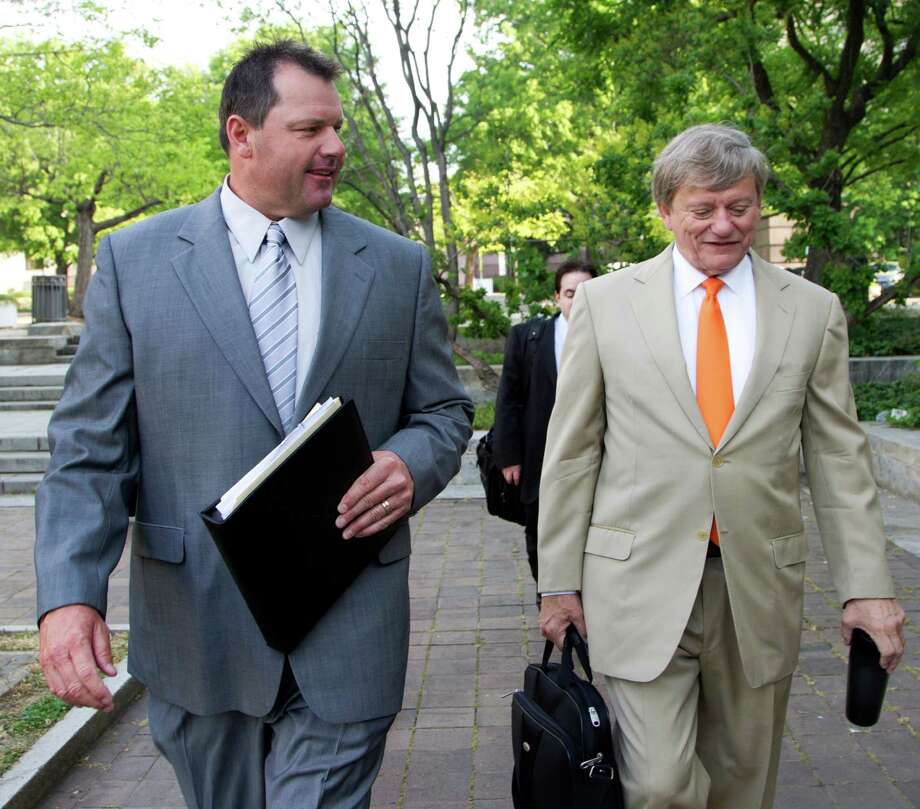 Former Major League Baseball pitcher Roger Clemens, and his attorney Rusty Hardin, arrive at federal court in Washington in Washington, Monday, April 16, 2012, for jury selection in the perjury trial on charges that he lied when he told Congress he never used steroids and human growth hormone.  (AP Photo/Manuel Balce Ceneta) Photo: Manuel Balce Ceneta, STF / AP